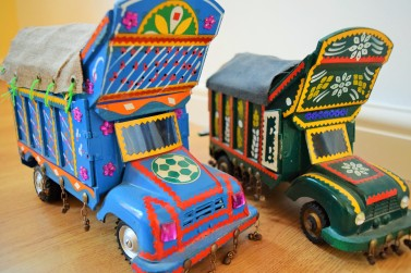 """Jingly jangly"" trucks were everywhere in Pakistan. We couldn't resist buying some mini ones to come home with us."