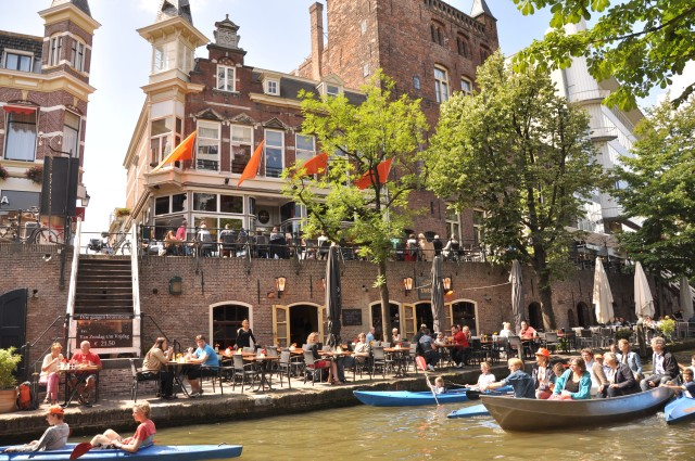 The Utrecht canals on a sunny day are packed with boats